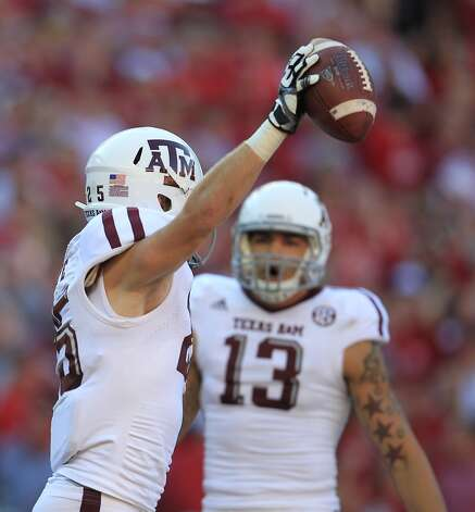 Texas A&M wide receiver Ryan Swope (25) celebrates his touchdown catch in the end zone during the first quarter of a college football game at Bryant-Denny Stadium, Saturday, Nov. 10, 2012, in Tuscaloosa.  ( Karen Warren / Houston Chronicle ) (Houston Chronicle)
