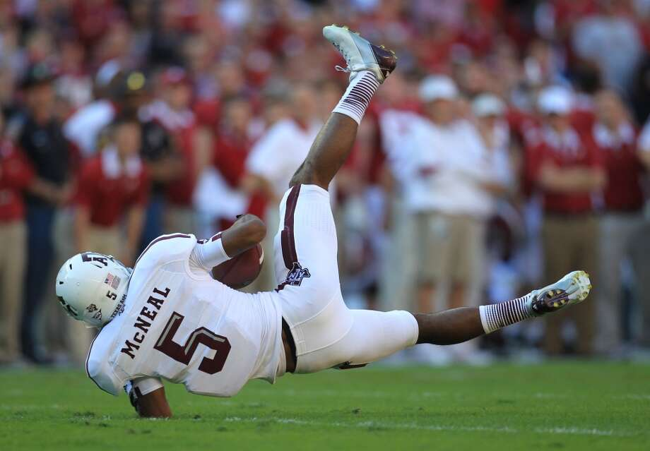 Texas A&M wide receiver Kenric McNeal (5) falls to the ground after making a catch during the first quarter of a college football game at Bryant-Denny Stadium, Saturday, Nov. 10, 2012, in Tuscaloosa.  ( Karen Warren / Houston Chronicle ) (Houston Chronicle)