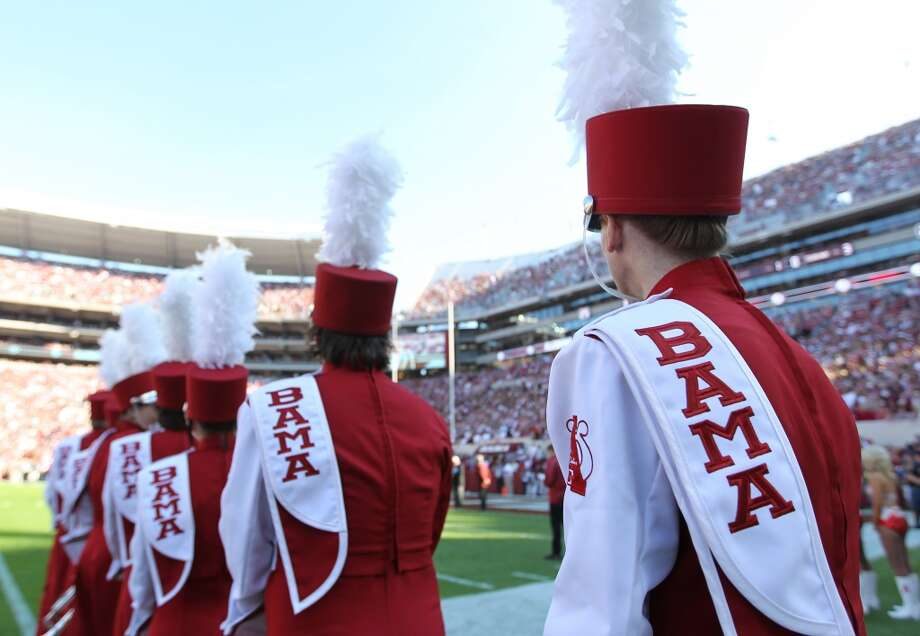 A member of the Alabama band prepares to take the field before the start of a college football game at Bryant-Denny Stadium, Saturday, Nov. 10, 2012, in Tuscaloosa.  ( Karen Warren / Houston Chronicle ) (Houston Chronicle)