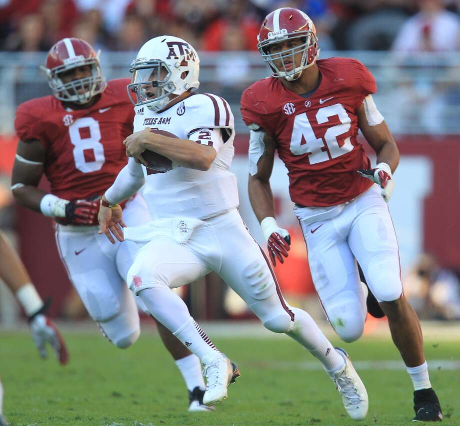 Texas A&M quarterback Johnny Manziel (2) scrambles for yardage during the first quarter of a college football game at Bryant-Denny Stadium, Saturday, Nov. 10, 2012, in Tuscaloosa.  ( Karen Warren / Houston Chronicle ) (Houston Chronicle)