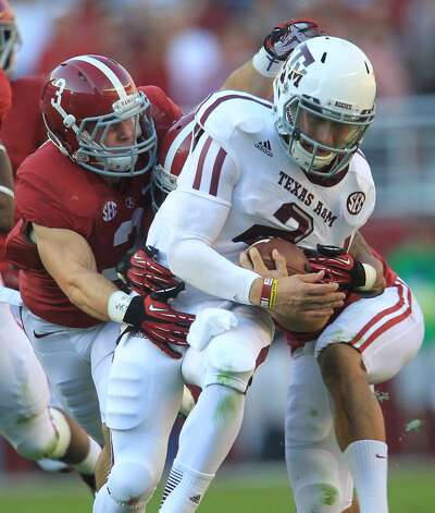 Texas A&M quarterback Johnny Manziel (2) is tackled by Alabama defensive back Vinnie Sunseri (3) during the first quarter of a college football game at Bryant-Denny Stadium, Saturday, Nov. 10, 2012, in Tuscaloosa.  ( Karen Warren / Houston Chronicle ) (Houston Chronicle)