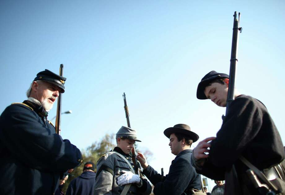Members of the Washington Civil War Association check their rifles before marching in the Auburn Veterans Day Parade. Photo: JOSHUA TRUJILLO / SEATTLEPI.COM
