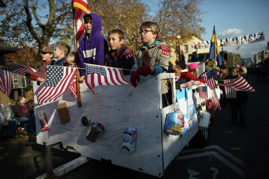 Members of Boy Scout troops 306, 323, and 343 of Auburn ride in the Auburn Veterans Day Parade. Photo: JOSHUA TRUJILLO / SEATTLEPI.COM