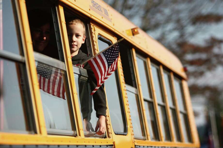 Participants ride in a bus during the Auburn Veterans Day Parade. Photo: JOSHUA TRUJILLO / SEATTLEPI.COM