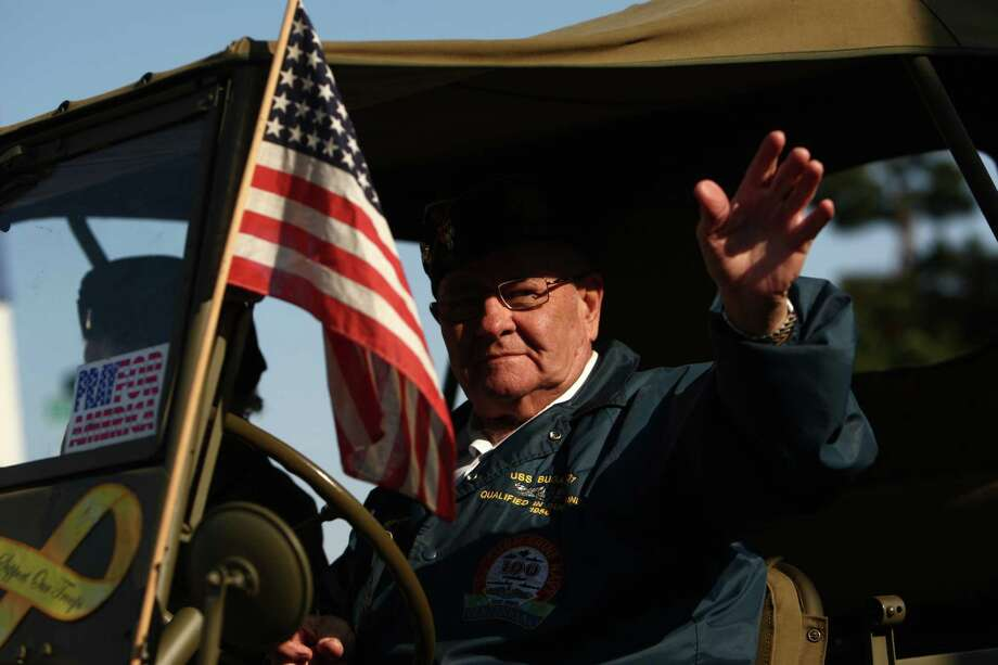 A participant drives a military vehicle during the Auburn Veterans Day Parade. Photo: JOSHUA TRUJILLO / SEATTLEPI.COM