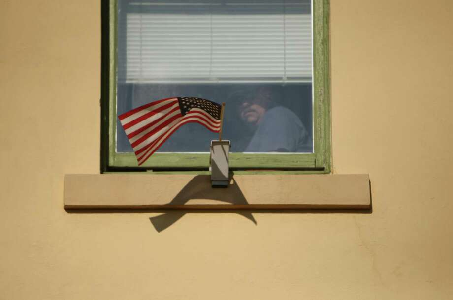 A spectator watches the Auburn Veterans Day Parade. Photo: JOSHUA TRUJILLO / SEATTLEPI.COM