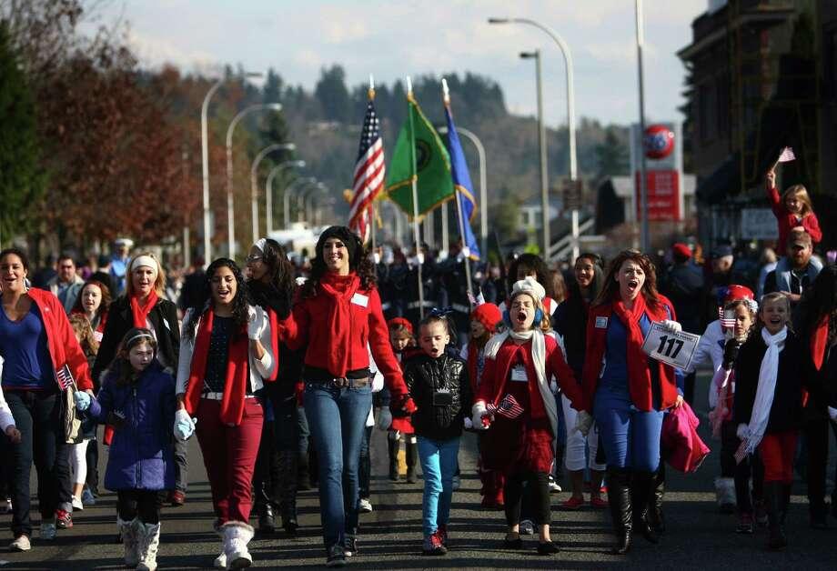 Members of the Miss Auburn Scholarship program march in the Auburn Veterans Day Parade. Photo: JOSHUA TRUJILLO / SEATTLEPI.COM