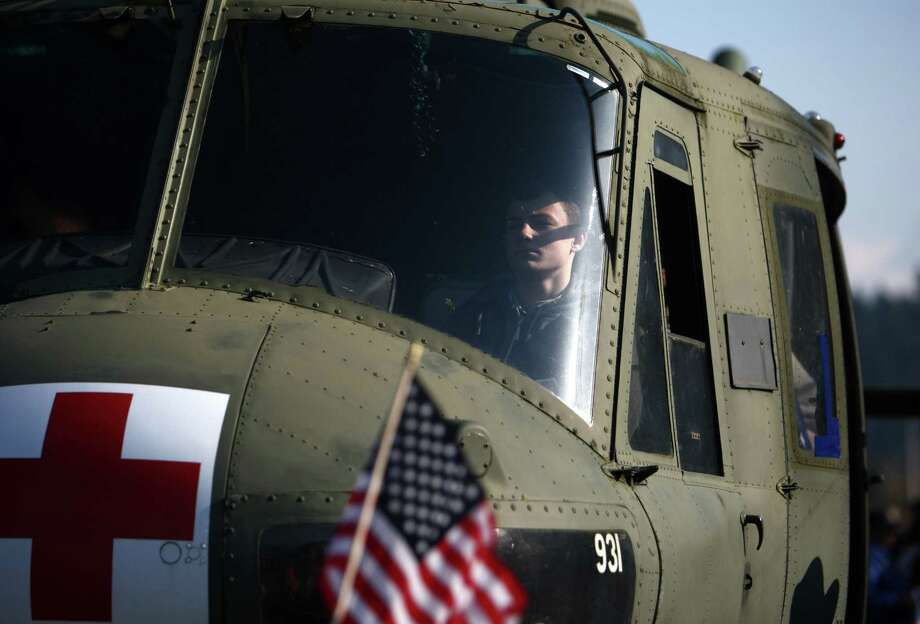 A participant sits in a helicopter during the Auburn Veterans Day Parade. Photo: JOSHUA TRUJILLO / SEATTLEPI.COM