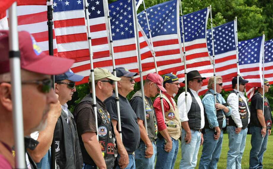 A Patriot Guard Riders color guard during a ceremony to inter the unclaimed remains of 8 veterans, from WWI, WWII, and Vietnam at the Solomon Saratoga National Cemetery in Schuylerville Friday June 8, 2012.   (John Carl D'Annibale / Times Union) Photo: John Carl D'Annibale / 00018014A