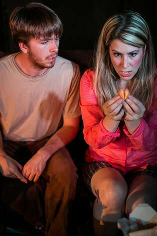 "Matt (Will Hand, left) and Beth (Jeanette Penley) ask a cookie for clues to their future in Lauren Gunderson's ""Toil and Trouble"" at Impact Theatre Photo: Cheshire Isaacs"