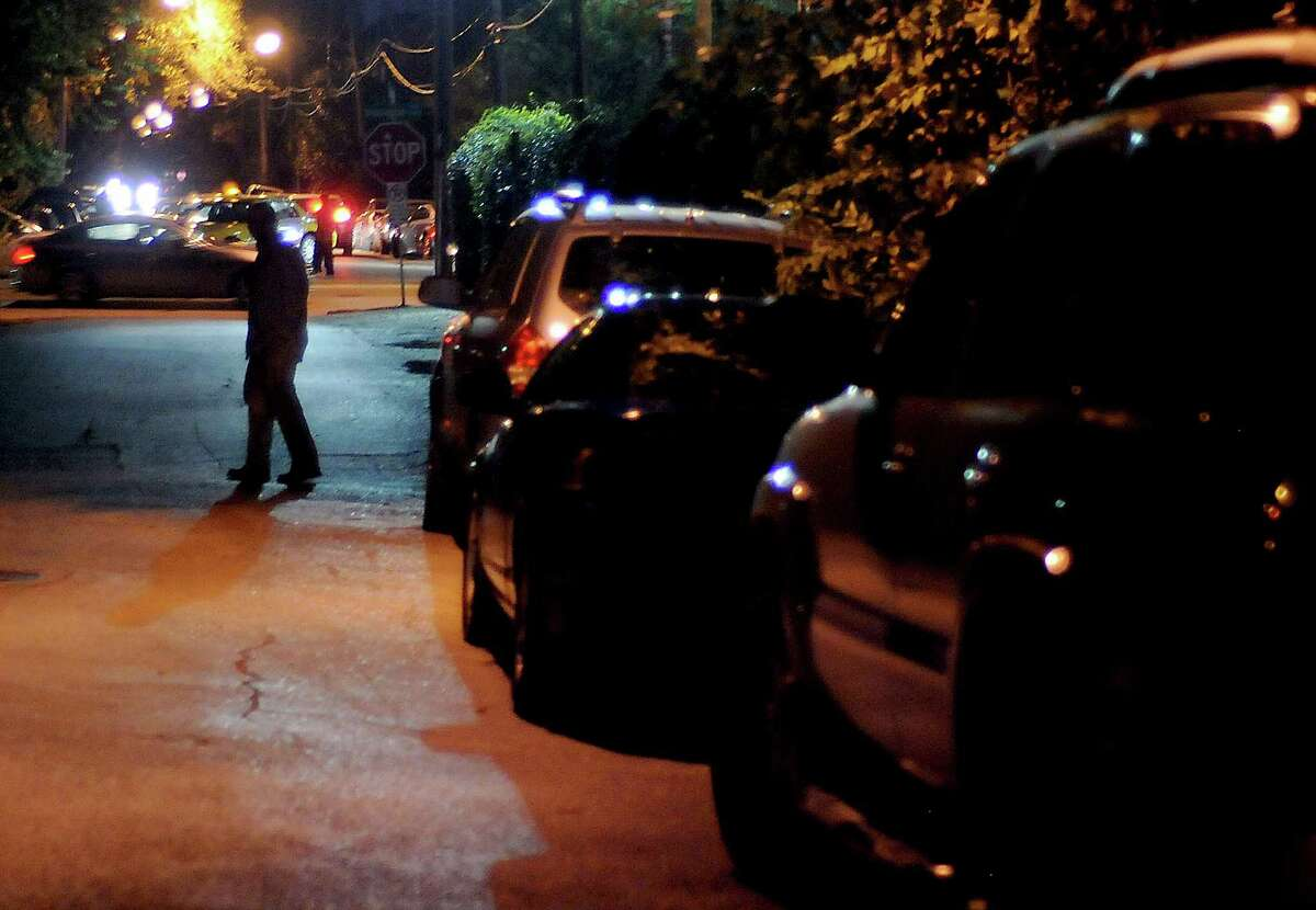A man heads to Washington Avenue after parking in a neighborhood west of Shepherd Friday Nov. 09,2012.
