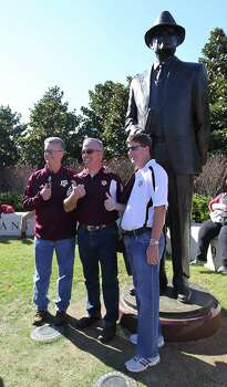 Texas A&M fans David Cunningham, left, Daryl Heath, center and Kyle Walker get their photos taken in front of the Bear Bryant statue before the start of a college football game at Bryant-Denny Stadium, Saturday, Nov. 10, 2012, in Tuscaloosa. Photo: Karen Warren, Houston Chronicle / © 2012  Houston Chronicle