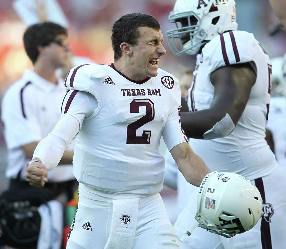 Texas A&M quarterback Johnny Manziel (2) as the touchdown was called after review during the first quarter of a college football game at Bryant-Denny Stadium, Saturday, Nov. 10, 2012, in Tuscaloosa. Photo: Karen Warren, Houston Chronicle / © 2012  Houston Chronicle