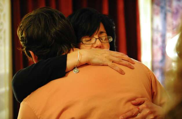 Virginia Krumwiede hugs a family friend at a memorial service which was held for her son, Jet Krumwiede, at Smith & Sefcik Funeral Home in Milford, Conn. on Saturday November 10, 2012. Krumwiede went missing in advance of Superstorm Sandy while kayaking with a friend. Photo: Christian Abraham / Connecticut Post