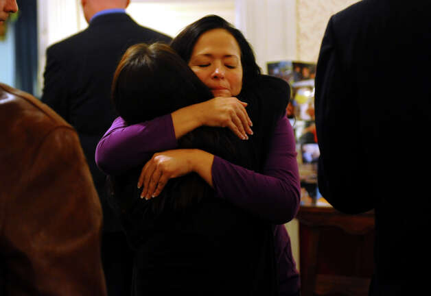 Tammy Piccolo, of Ansonia, facing camera, hugs Nicole Miller during a memorial service held for Miller's cousin Jet Krumwiede at Smith & Sefcik Funeral Home in Milford, Conn. on Saturday November 10, 2012. Krumwiede went missing in advance of Superstorm Sandy while kayaking with a friend. Photo: Christian Abraham / Connecticut Post