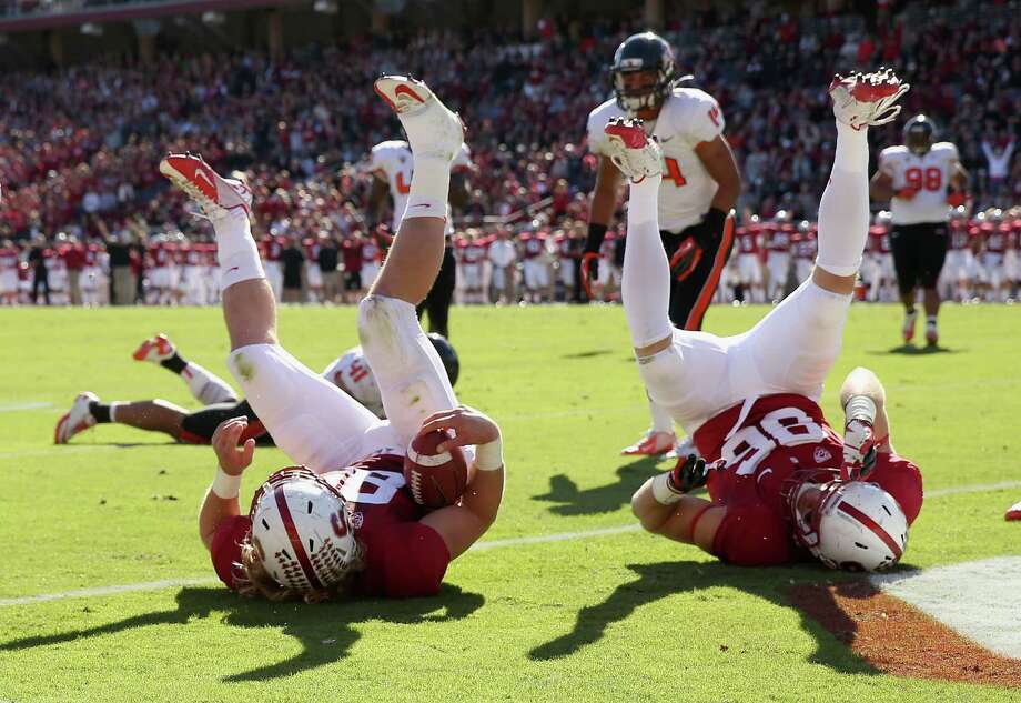Stanford's Ryan Hewitt, left, scores a touchdown and is copied by Zach Ertz, minus the football. Photo: Ezra Shaw, Staff / 2012 Getty Images