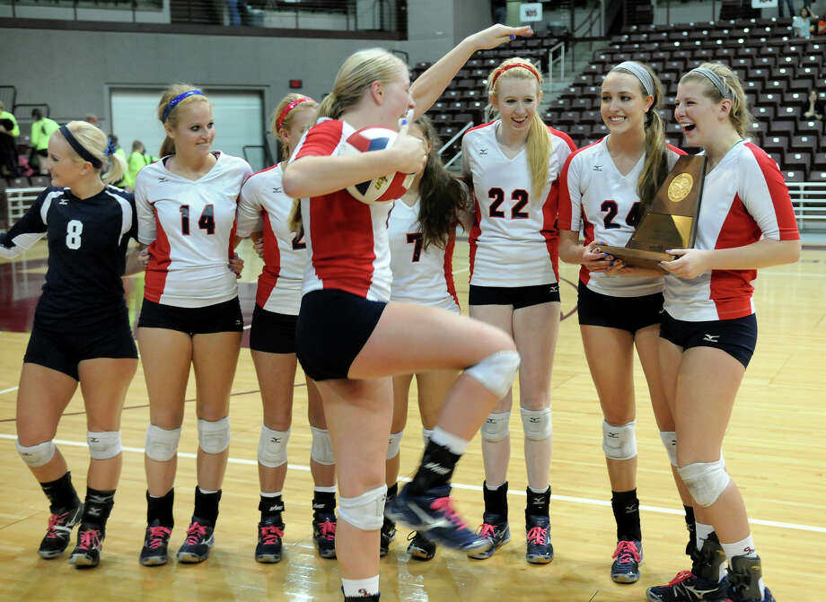 Clear Lake junior outside hitter Megan Rasmussen, center, dances with the game ball for her teammates, including seniors Sarah Sciacca, from right, Sarah Strasner, Alanna Winfield, Sam Volk, Ashley Ellis, Lindsey Ideler, and Ashlyn Smith after the Lady Falcons defeated the Clear Falls Lady Knights in their Region III 5A volleyball championship at the M.O. Campbell Educational Center on Saturday. Photo by Jerry Baker Photo: Jerry Baker, For The Chronicle