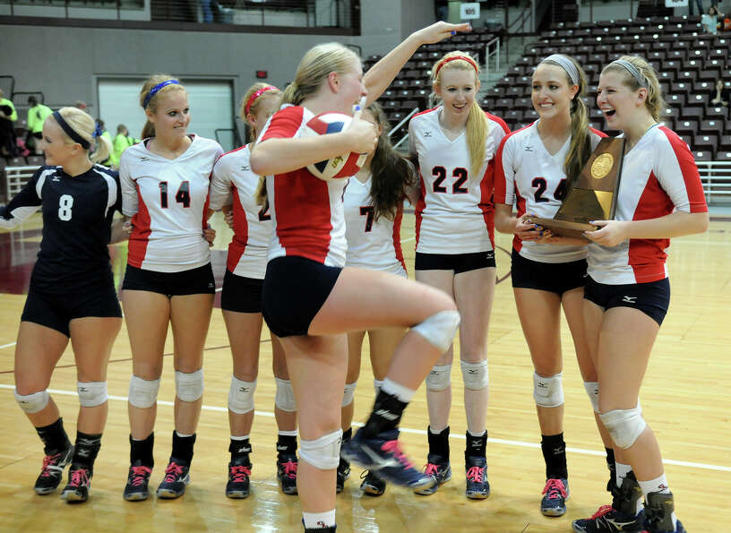 Clear Lake junior outside hitter Megan Rasmussen, center, dances with the game ball for her teammate