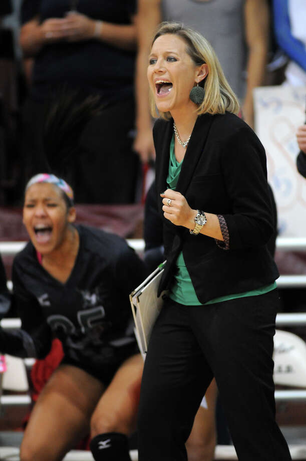Clear Falls Head Coach Lyndsay Hodges gets excited during the Lady Knight's Region III 5A Regional Final versus the Clear Lake Lady Falcons at the M.O. Campbell Educational Center on Saturday. Photo by Jerry Baker Photo: Jerry Baker, For The Chronicle