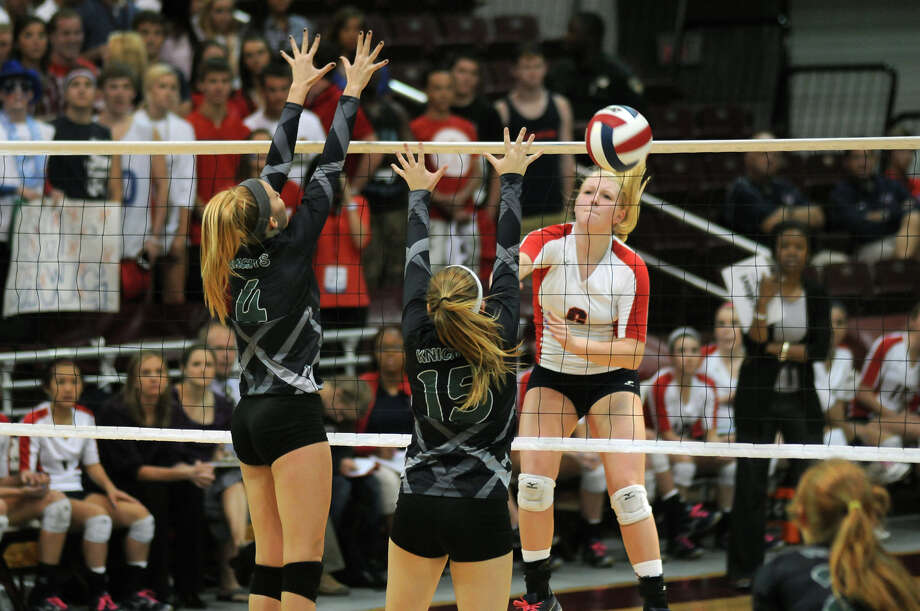 Clear Lake junior outside hitter Megan Rasmussen, from right, sends a kill past Clear Falls middle blocker Allison York and teammate Katie Bludau in their Region III 5A Regional Final at the M.O. Campbell Educational Center on Saturday. Photo by Jerry Baker Photo: Jerry Baker, For The Chronicle