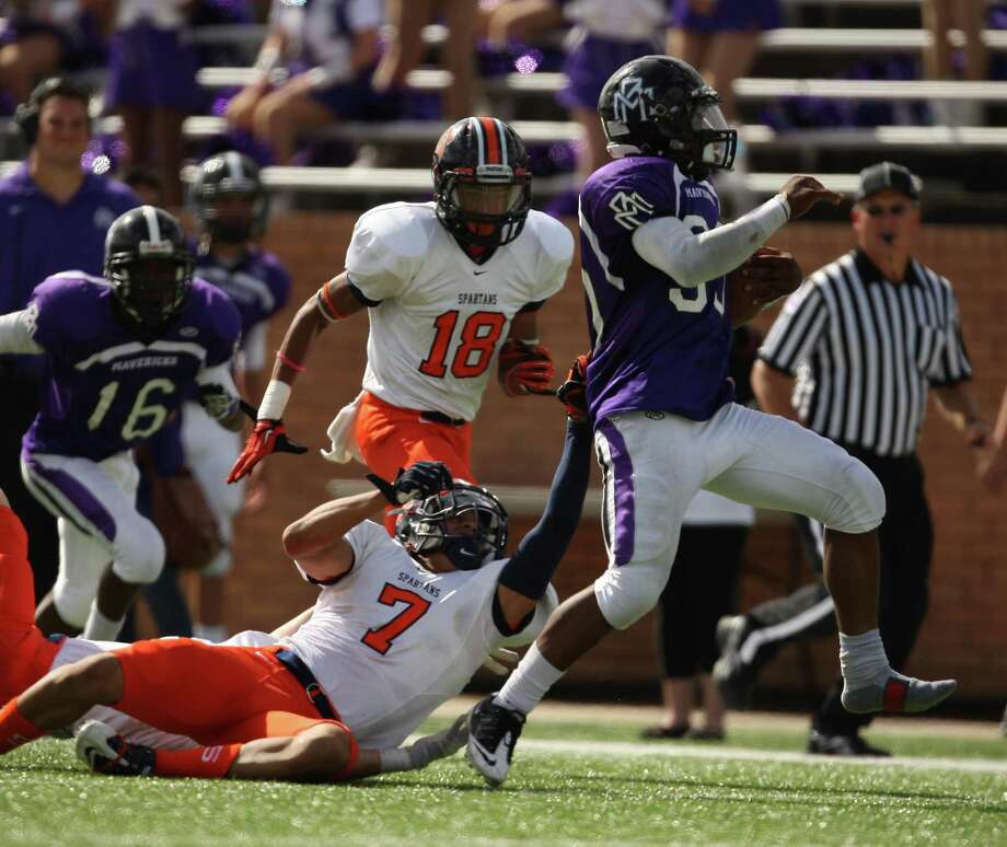 Running with one shoe, Morton Ranch running back Deion Williams (right) escapes the tackle of Seven Lakes defensive back Ryan Sigers (7) during the second half of a high school football game, Saturday, November 11, 2012 at Rhodes Stadium in Katy, TX. Photo: Eric Christian Smith, For The Chronicle