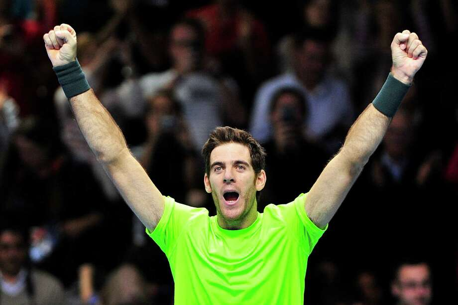 Argentina's Juan Martin Del Potro celebrates beating Switzerland's Roger Federer and qualifying for the semi-finals in their group B singles match in the round robin stage on the sixth day of the ATP World Tour Finals tennis tournament in London on November 10, 2012.      AFP PHOTO / GLYN KIRKGLYN KIRK/AFP/Getty Images Photo: GLYN KIRK / AFP