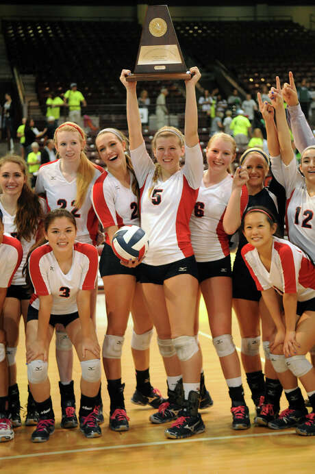 Middle blocker Sarah Sciacca (5) and her Clear Lake teammates are moving on to the Class 5A state tournament after claiming the Region III title. Photo: Jerry Baker, Freelance