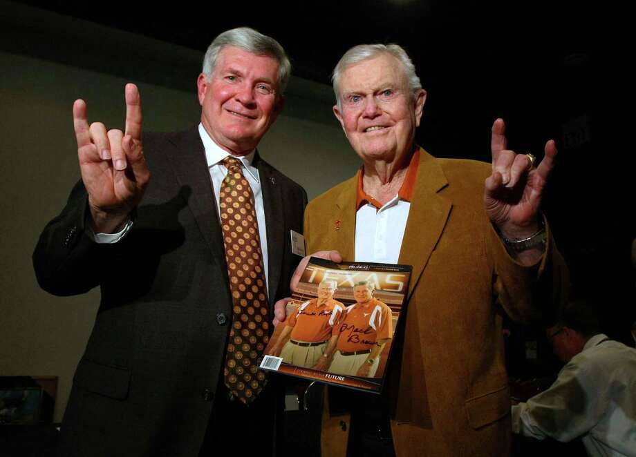 "FILE - This Feb. 29, 2012 file photo shows Texas football coach Mack Brown, left, giving the ""hook 'em horns"" sign with former coach Darrell Royal at a reception before the induction for the 2012 class of the Texas Sports Hall of Fame in Waco, Texas. The University of Texas says former football coach Darrell Royal, who won two national championships and a share of a third, has died. He was 88. UT spokesman Nick Voinis on Wednesday, Nov. 7, 2012 confirmed Royal's death in Austin. (AP Photo/Waco Tribune Herald,  Jerry Larson, File) Photo: Jerry Larson, MBO / Waco Tribune Herald"