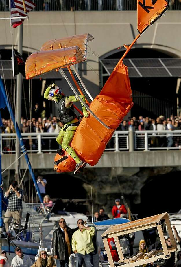Team Kitty Zazzlers piloted by Trevor Shanklin from Sacramento rides the craft as the water approaches during the competition on Saturday Nov. 10, 2012. Flugtag, the outrageous human powered flying competition returns to San Francisco, Calif. after a ten year absence. Photo: Michael Macor, The Chronicle
