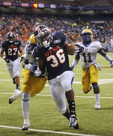 UTSA 31  - McNeese State 24: UTSA running back Evans Okotcha (36) scores against McNeese State during third-quarter action in the Alamodome on Saturday, Nov. 10, 2012. (San Antonio Express-News)