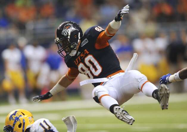 UTSA receiver Cole Hicks is knocked airborne after unsuccessfully lunging for a pass during college football action against McNeese State in the Alamodome on Saturday, Nov. 10, 2012. (San Antonio Express-News)