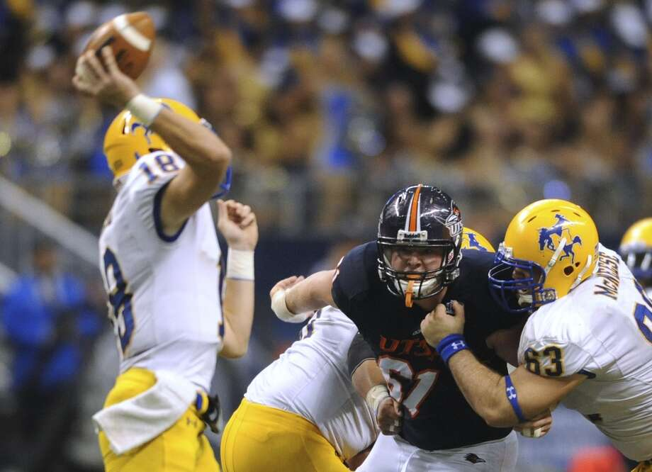 Defensive tackle Richard Burge (61) of UTSA bears down on McNeese State quarterback Cody Stroud during college football action in the Alamodome on Saturday, Nov. 10, 2012. (San Antonio Express-News)