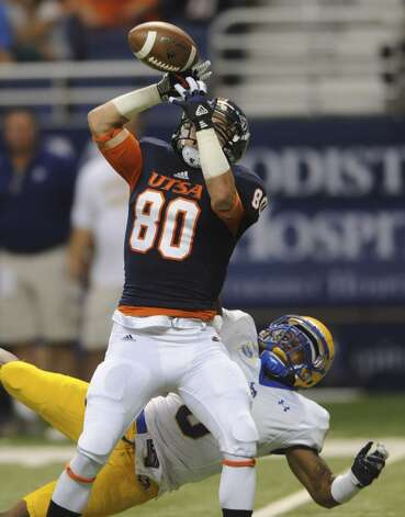 UTSA receiver Cole Hicks is unable to catch a pass as cornerback Seth Thomas of McNeese State defends during college football action in the Alamodome on Saturday, Nov. 10, 2012. (San Antonio Express-News)