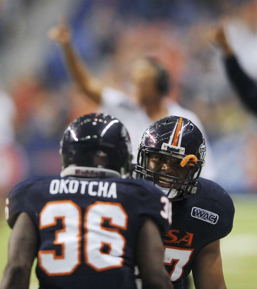 UTSA running back Nate Shaw and teammate Evans Okotcha celebrate after a score against McNeese State in the Alamodome on Saturday, Nov. 10, 2012. (San Antonio Express-News)