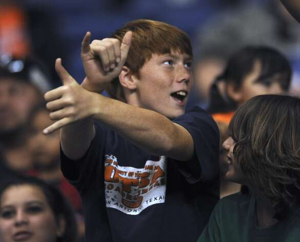 "Jack Perkins, 12, celebrates a UTSA score by dancing ""Gangnam"" style in the Alamodome on Saturday, Nov. 10, 2012. (San Antonio Express-News)"