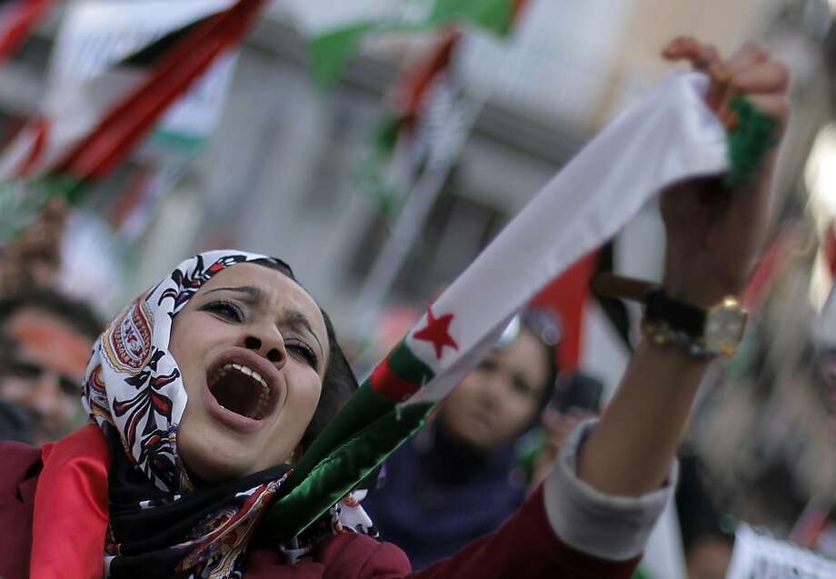 A woman from Western Sahara shouts slogans in support of Free Western Sahara during a protest in Madrid, Saturday, Nov. 10, 2012. (AP Photo/Andres Kudacki) Photo: Andres Kudacki, Associated Press