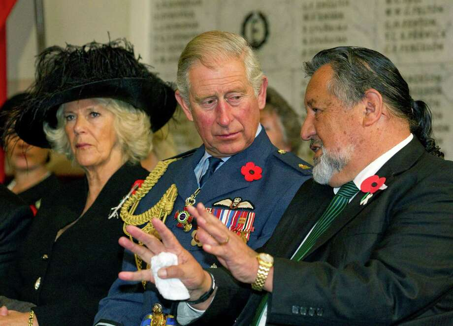 Britain's Prince Charles listens to Maori official Pita Sharples on Sunday as he and his wife, Camilla, the Duchess of Cornwall, attend an Armistice Day service. Photo: Nigel Marple, POOL / Pool Reuters