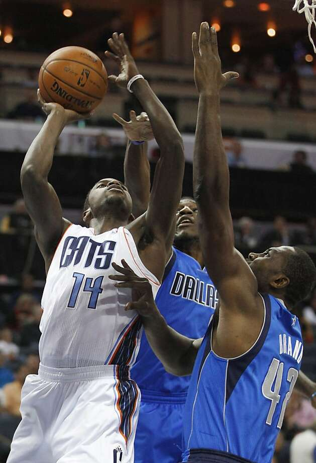 Charlotte Bobcats' Michael Kidd-Gilchrist (14) tries to shoot over Dallas Mavericks' Elton Brand (42) and Jae Crowder, back, during the first half of an NBA basketball game in Charlotte, N.C., Saturday, Nov. 10, 2012. (AP Photo/Chuck Burton) Photo: Chuck Burton, Associated Press