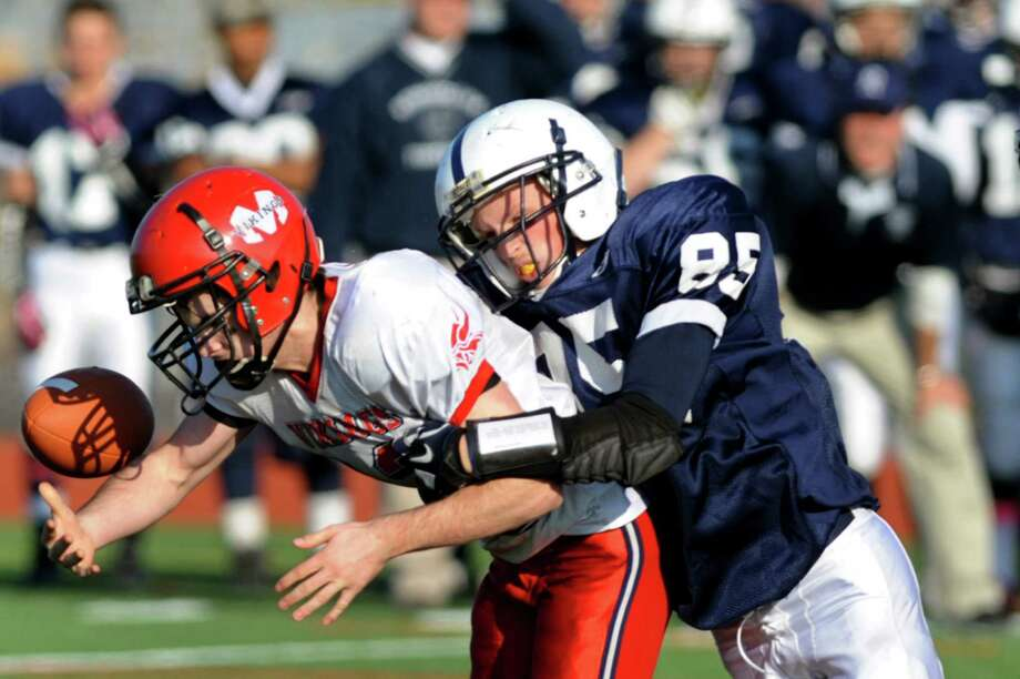 The ball pops loose when Rensselaer's Tyler Stasack (85), right, sacks Moriah's quarterback Tyler Pratt (12) during their Class D regional football game against Moriah on Saturday, Nov. 10, 2012, at Schuylerville High in Schuylerville, N.Y. (Cindy Schultz / Times Union) Photo: Cindy Schultz / 00020055A