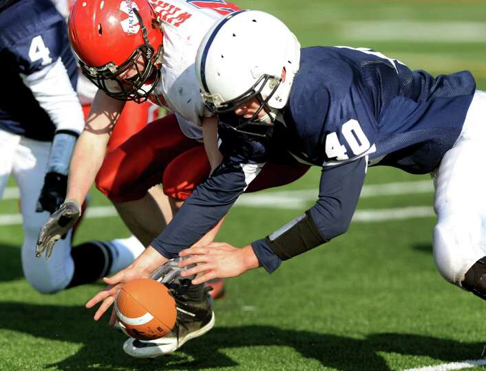 Rensselaer's James Stevens (40), right, and Moriah's Cameron Wright (32) dive on a fumbled ball duri