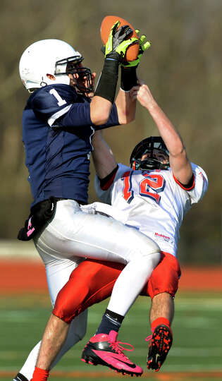 Rensselaer's Tyler Oliver (1), left, hauls in a pass as Moriah's Tyler Pratt(12) defends during thei