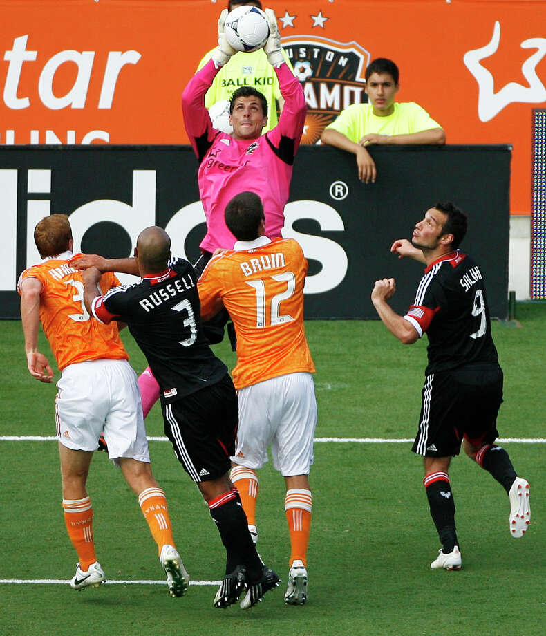 Dynamo keeper Tally Hall, soaring above the fray, set a franchise record with 12 shutouts this season. Photo: James Nielsen, Staff / © Houston Chronicle 2012