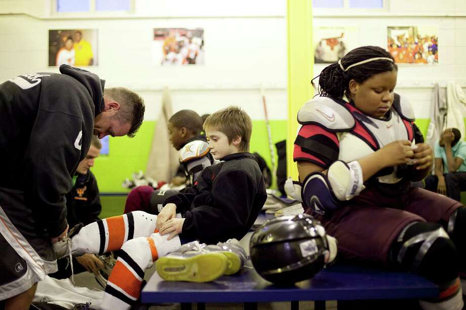 Players from the Ed Snider Youth Hockey Foundation at Simons Ice Rink in North Philadelphia, Dec. 21, 2011. If not for Snider, the founder of the Flyers in 1967 and the longest-serving member of the NHL Board of Governors, it is possible that the passion for the sport that blankets Philadelphia would not exist. (Ryan Collerd/The New York Times) Photo: RYAN COLLERD / NYTNS