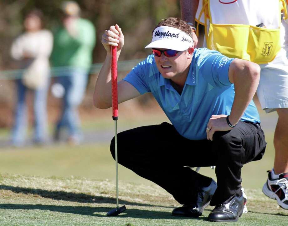 Charlie Beljan lines up his putt on the eighth green during the third round of the Children's Miracle Network Hospitals golf tournament in Lake Buena Vista, Fla., on Saturday, Nov. 10, 2012. (AP Photo/Reinhold Matay) Photo: Reinhold Matay