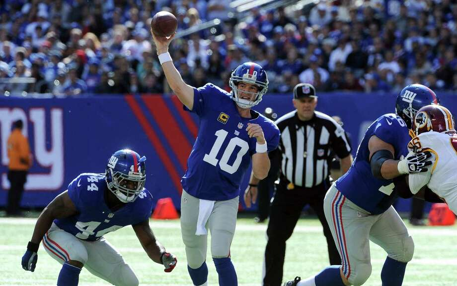 New York Giants quarterback Eli Manning (10) passes in the first half of an NFL game against the Washington Redskins at MetLife Stadium in East Rutherford, N.J., Oct. 21, 2012. (Barton Silverman/The New York Times) Photo: BARTON SILVERMAN / NYTNS