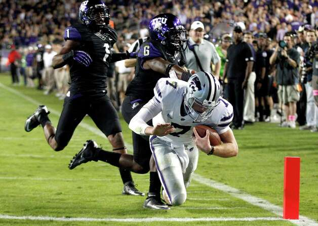 Kansas State quarterback Collin Klein (7) scores a touchdown against TCU defenders Elisha Olabode (6) and Chris Hackett (1) during the third quarter of an NCAA college football game, Saturday, Nov. 10, 2012, in Fort Worth, Texas. (AP Photo/LM Otero) Photo: LM Otero, Associated Press / AP