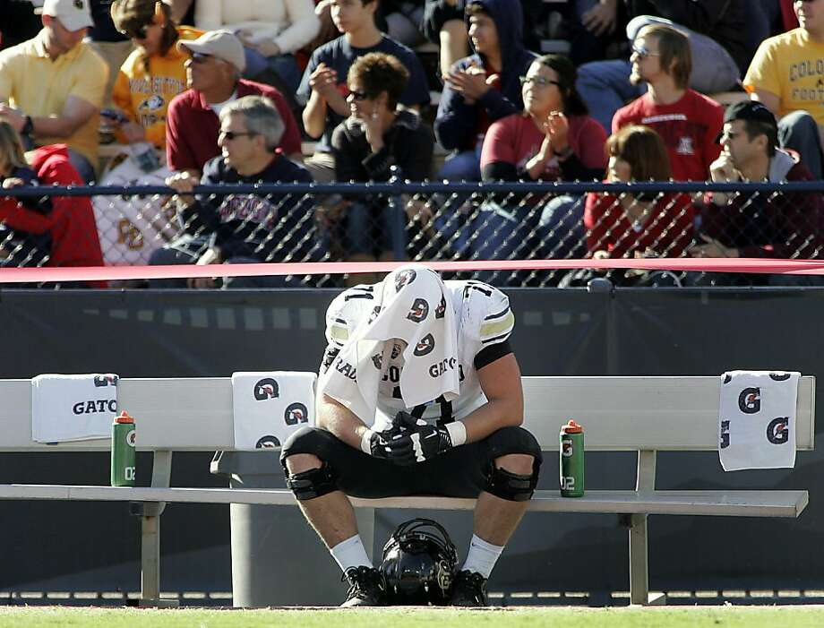 Colorado's Alexander Lewis (71) reacts on the bench during the fourth quarter in an NCAA college football game against Arizona at Arizona Stadium in Tucson, Ariz., Saturday, Nov. 10, 2012. Arizona won 56 - 31. (AP Photo/John Miller) Photo: John Miller, Associated Press