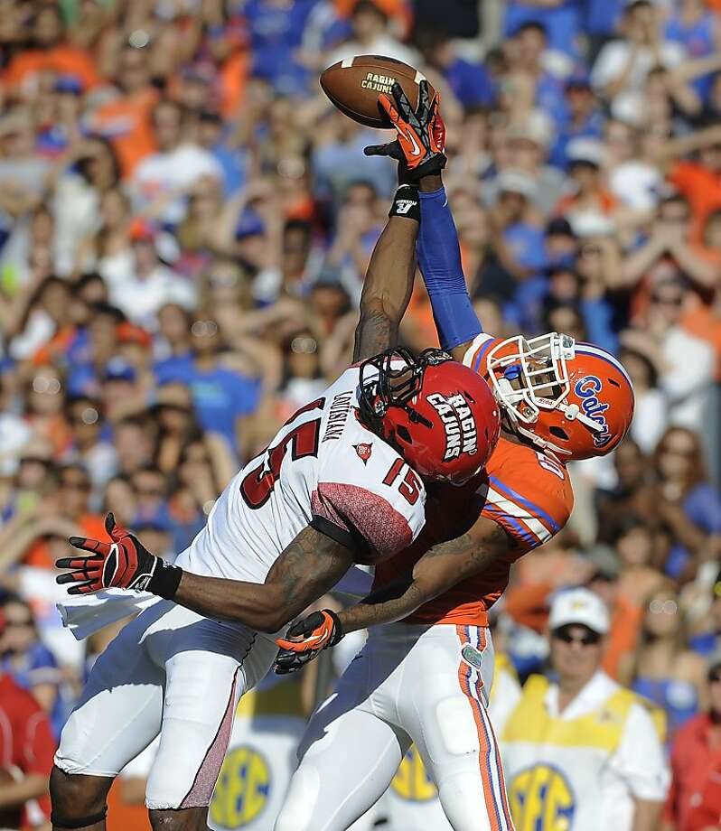 Florida defensive back Marcus Roberson (5) breaks up a pass intended for Louisiana-Lafayette wide receiver Jamal Robinson (15) during the second half of an NCAA college football game in Gainesville, Fla., Saturday, Nov. 10, 2012. Florida won 27-20. (AP Photo/Phil Sandlin) Photo: Phil Sandlin, Associated Press