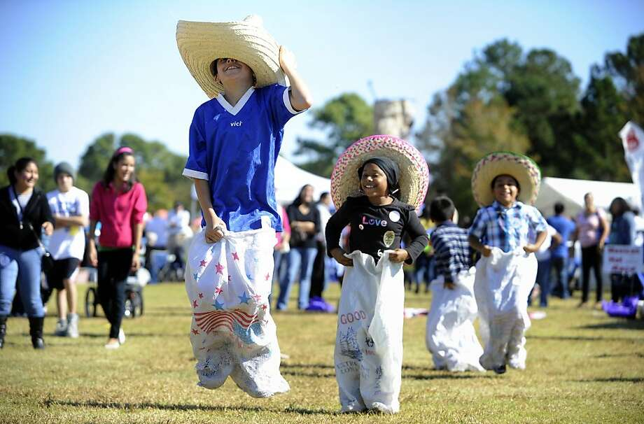 Ricky Altamirano, 10, takes the lead in Second Chance Angel's Mexican Hat Dance Saturday, Nov. 10, 2012 during the 13th Annual Festival Latino in Wilmington, N.C.  (AP Photo/The Star-News, Jeff Janowski) Photo: Jeff Janowski, Associated Press