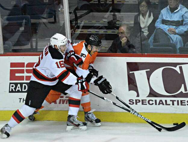 Devils' #16 Chad Wiseman ,left, and Adirondack's #20 Cullen Eddy during Saturday night's game at the Times Union Center in Albany Nov. 10, 2012.  (John Carl D'Annibale / Times Union) Photo: John Carl D'Annibale / 00020057A